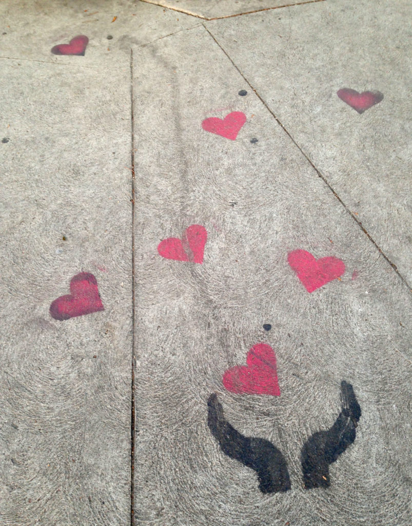 street art los angeles melrose hand and hearts sidewalk art